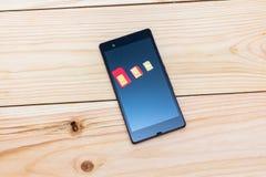 Карточки SIM различного форм-фактора на smartphone Стоковая Фотография