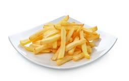 Картошки жарят в плите изолированной на белой предпосылке Стоковое Фото
