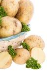 Картошки и петрушка в корзине Стоковые Фотографии RF