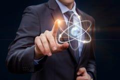 Касания бизнесмена атома Стоковое фото RF