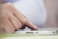 Касающая цифровая таблетка Стоковая Фотография