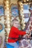 Катание девушки на carousel Стоковое фото RF