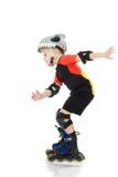 Катание мальчика на роликах Стоковое фото RF