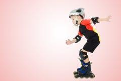 Катание мальчика на роликах Стоковая Фотография RF