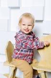 Катание ребенка на лошади игрушки Стоковое Фото