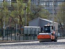 Каток асфальта открыт в новом месте для стоянки Стоковое Фото