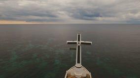 Католический крест в море видеоматериал