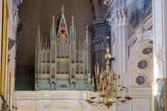 Каунас, Литва - 12-ое мая 2017: музыкальный орган внутри базилики собора St Peter и Пола kaunas Стоковое Изображение RF