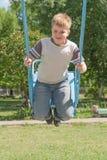 качание мальчика Стоковая Фотография