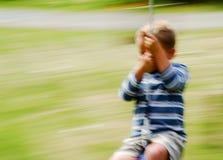 качание мальчика Стоковое Фото