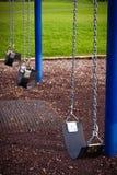качание спортивной площадки малышей детали Стоковое фото RF