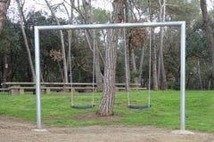 Качания в парке для детей Стоковое Изображение RF