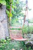 Качания в саде ослабляя Стоковые Фото
