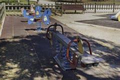 Качания в спортивной площадке Стоковая Фотография RF