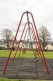 Качания на игровой площадке детей Стоковое Изображение