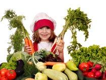 Кашевар маленькой девочки с овощами стоковая фотография rf