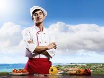 Кашевар на кухне стоковое изображение