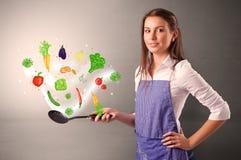 Кашевар с красочными нарисованными овощами стоковые изображения