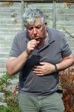 кашлять пожилой человек Стоковые Изображения RF