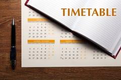 Календарь стены с крупным планом ручки и дневника Стоковое фото RF