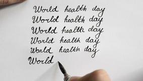 Каллиграфия дня здоровья мира и lattering Шестая линия Взгляд сверху видеоматериал