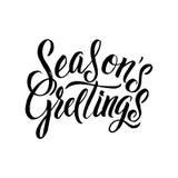 Каллиграфия приветствиям сезонов Оформление черноты поздравительной открытки на белой предпосылке Стоковое фото RF