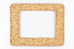 2 кадра сделанного веревочки с зерном овсов на белом backgroun Стоковая Фотография RF