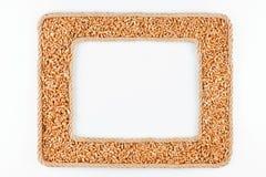 2 кадра сделанного веревочки с зерном пшеницы на белом backgro Стоковое фото RF