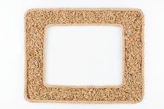 2 кадра сделанного веревочки с зерном рож на белой предпосылке Стоковое Изображение RF