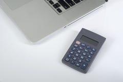 Калькулятор и компьтер-книжка иллюстрация штока