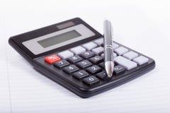 Калькулятор и ручка Стоковая Фотография