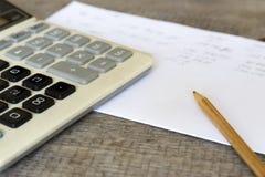 Калькулятор, карандаш и вычисления Стоковая Фотография