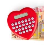 Калькулятор красного сердца форменный с банкнотами евро Стоковые Фото