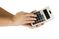 Калькулятор пользы руки женщины Стоковое Фото