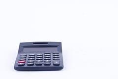 Калькулятор для высчитывать вычисление дела бухгалтерского учета номеров учитывая на белом вид спереди предпосылки Стоковые Фото
