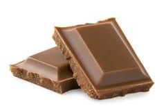 2 квадрата молочного шоколада изолированного на белизне Грубые края стоковые изображения rf
