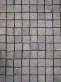 Квадратные серые плитки на поле или стене Ржавые серые wi предпосылки Стоковая Фотография RF