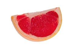 Квартал грейпфрута на белой предпосылке Стоковые Фото