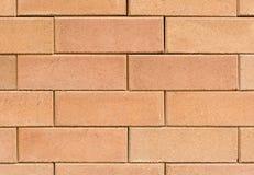 Квадратная оранжевая кирпичная стена Стоковое Изображение