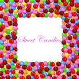 Квадратная предпосылка с различной сладостной конфетой на рамке Стоковое Фото