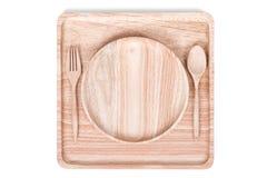 Квадратное деревянное блюдо установило с ложкой, на белой предпосылке Стоковое Изображение RF
