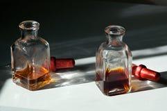 2 квадратных бутылки капельницы глаза Стоковое Изображение RF