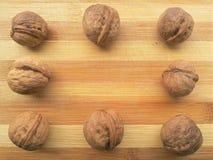 Квадрат раковины грецкого ореха на деревянной предпосылке Стоковая Фотография