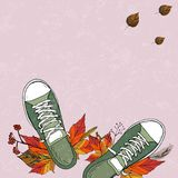 A pair of green textile sneakers royalty free illustration
