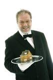 кельнер сервировки дома стоковая фотография