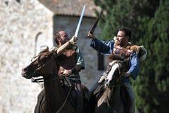Кельтское сражение рыцарей с верховыми лошадьми шпаг Стоковые Фото