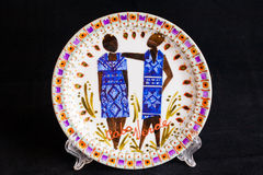 Керамическая плита с национальной диаграммой Изолировано на черноте Стоковое Фото