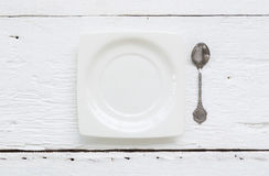 Керамические квадратные ложки плиты и чая десерта Стоковые Фото