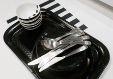 Керамические плиты, шары и столовый прибор на подносе Стоковые Фотографии RF