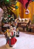 Керамический городок под рождественской елкой Стоковое фото RF